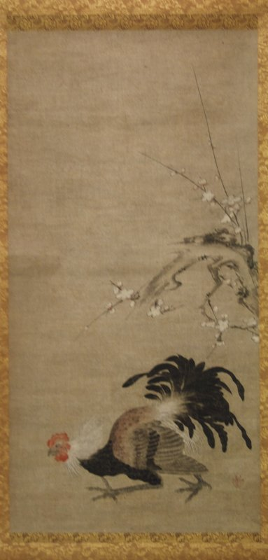 fierce looking rooster in profile walking with determination towards L side of scroll; portion of crooked branch with small white blossoms at center R edge