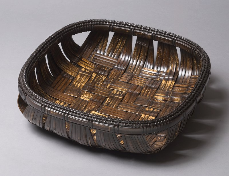 large, square basket with low walls and rounded edges; closed weave with wide strips; slightly rounded bottom