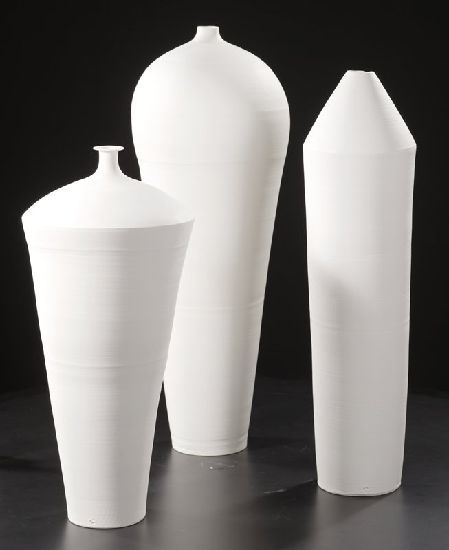 unglazed, tall, narrow, white porcelain vessel with narrow base, wide, bulbous top; very narrow raised mouth