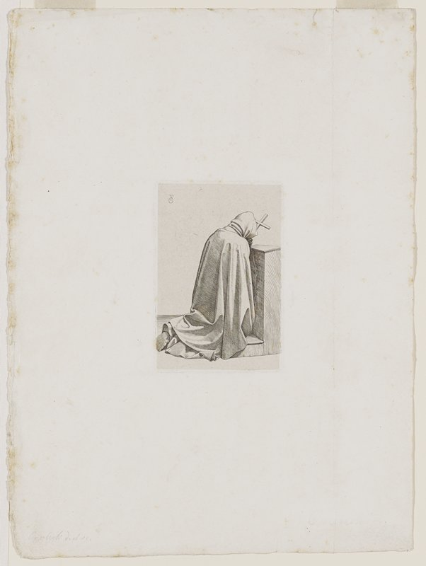 kneeling monk seen from behind, fully hooded with head bowed holding a cross