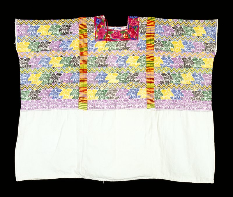 White cotton with brocaded bird, feathered serpent and plant designs on top 1/2 in purple, green, black, blue and yellow; striped embroidered randas across shoulders and joining sections of fabric in yellow, green, maroon, purple and red; floral embroidery is appliquéd on square neck