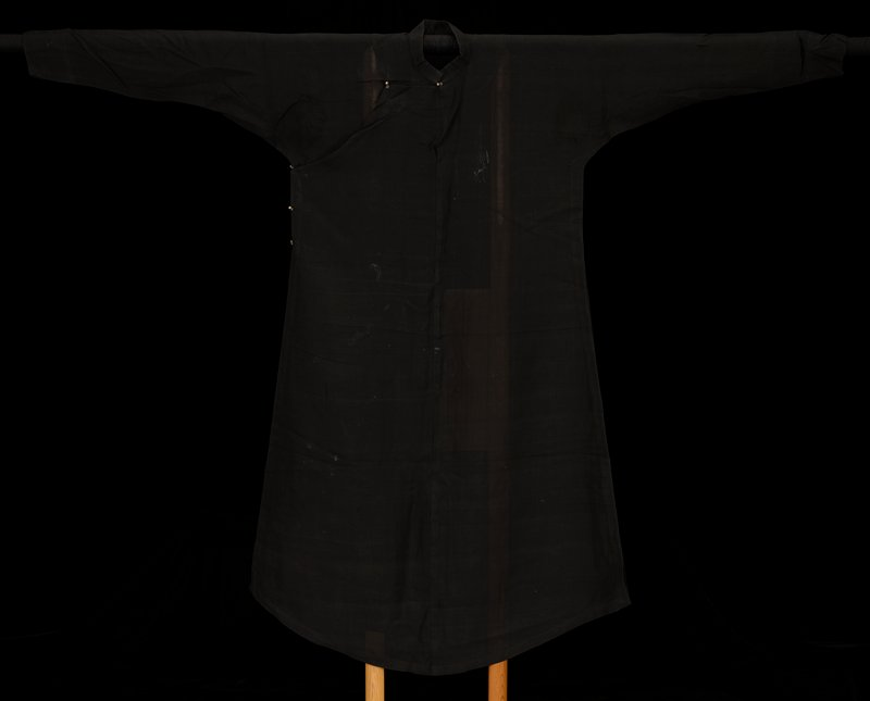 long-sleeved under robe of sheer black silk; tiny gold buttons; black metal snaps at cuffs