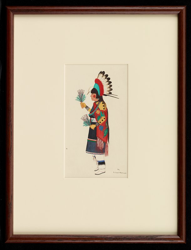figure seen in profile from PL, wearing a feathered headdress with green and red elements; red spot painted on figure's PL cheek; black and blue dress; red shawl with green floral patterns with blue and yellow flowers; figure holds a feathered fan with foliage in each hand; blue, black and white leggings; white moccasins with black soles