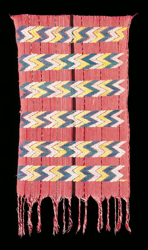 tzute; warp-faced red and white cotton with silk supplementary weft in blue, yellow and white; black band runs vertically through center