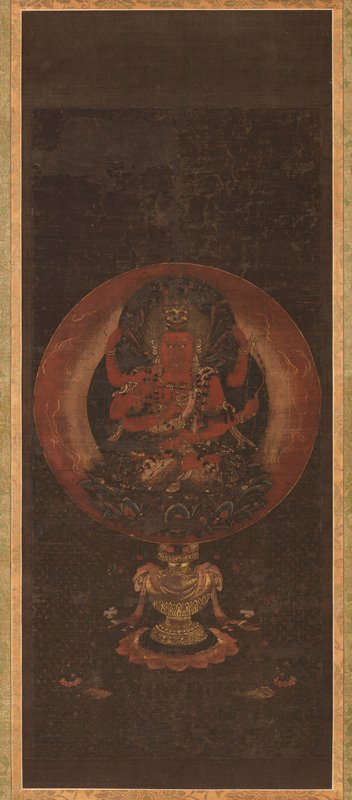 six armed red figure seated on lotus pedestal; each arm is holding a different object; large halo