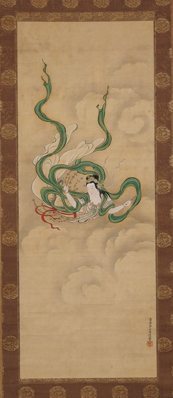 female figure soaring through clouds with long, trailing green sash; short wooden wand in each hand; strings of beads wafting around waist