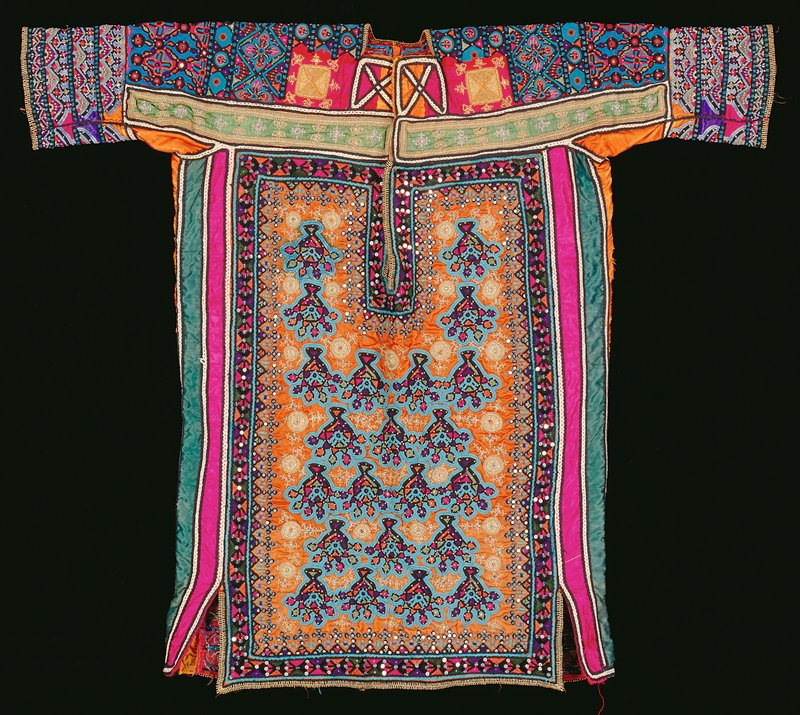 Shirt with long neck opening; allover multicolored embroidery in repeated organic designs on an orange ground on front and geometric and floral designs, predominately in blue and black, on back; sequins on front and metal disks on back