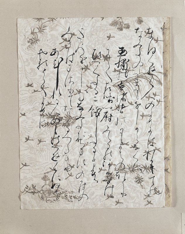 wispy cursive inscriptions against paper decorated with gold and silver foliage, pine cones