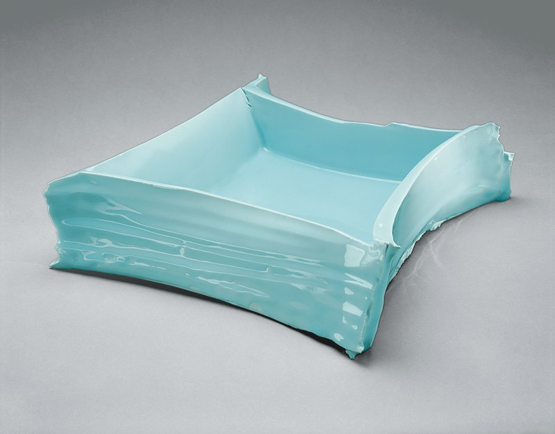 irregular square shaped vessel with low, ridged, concave walls that come together in points at the corners