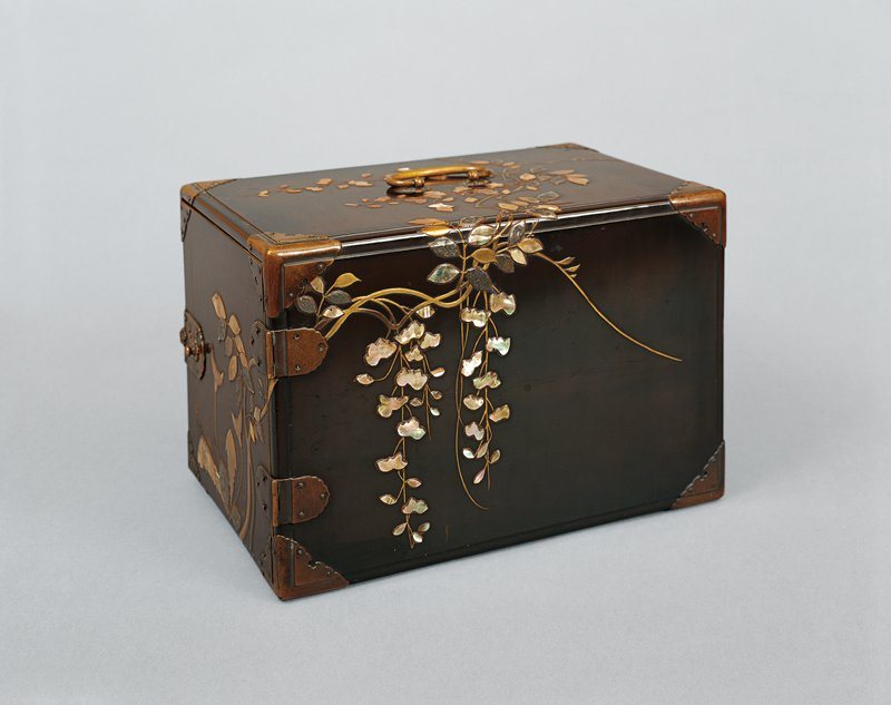 small chest with gilded copper hinges and corner fittings; design of dandelions and wisteria in shell and lead inlay and raised sprinkled design; three dragonflies on inside of the door; three removable shelves with floral pull; two keys