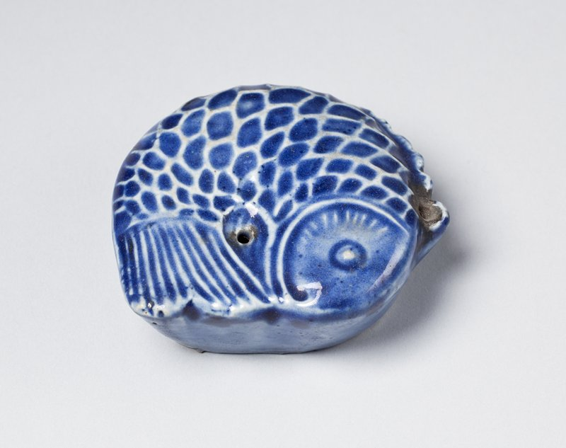 round ceramic water dropper in the shape of a fish; blue glaze