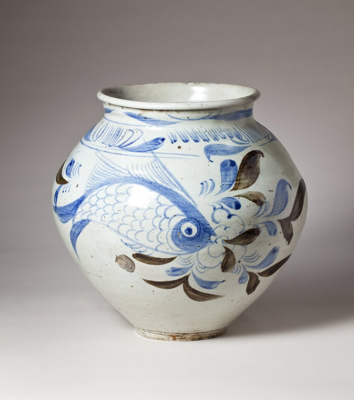 off-white porcelain jar with design of fish, flowers, leaves, and grasses in cobalt and iron oxide