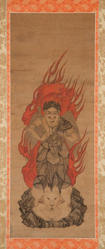 deity Izuna Gongen, with flames, wings, and beaklike nose, standing on a white fox with a flame; holding sword in PR hand, cord in PL; large billowing skirts