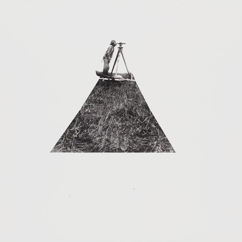 surveyor wearing a turban standing on a triangular image of grass