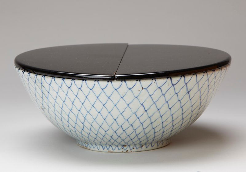 white bowl with blue fishnet pattern; two pieced black lacquer lid