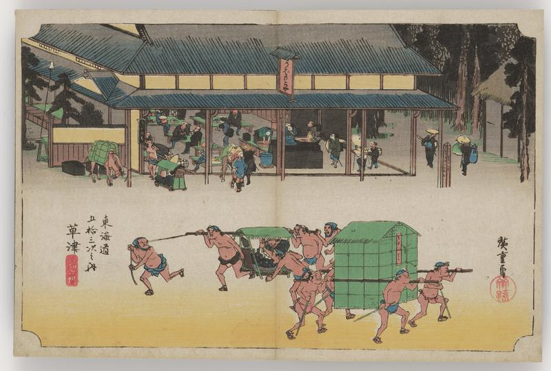 two groups of men in the street--one is carrying an open walled palanquin; the other carries a large box between two horizontal poles; large open-walled building in background with travelers resting at low tables; horse and palanquin parked outside of building