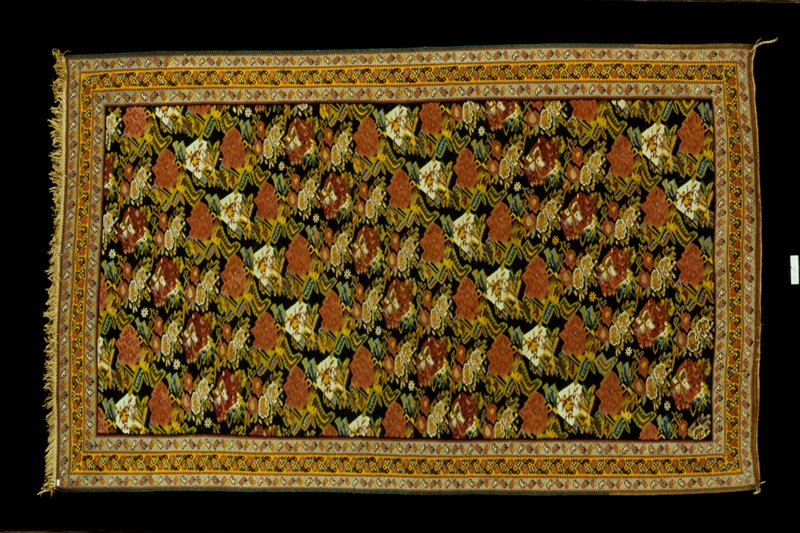 Khilim Rug A diagonal pink, flower and foliage pattern filling the center with three borders around the edge.