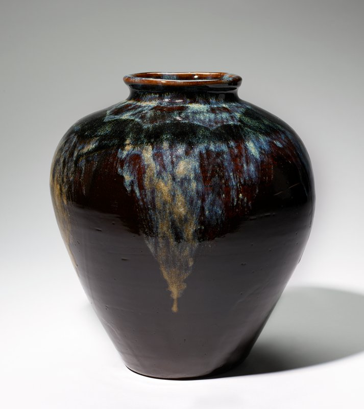 Jar Takatori pottery; ovoid form with small foot, wide shoulders and short neck with expanding lip; covered with thick glaze of brownish violet splashed with running gray-blue.