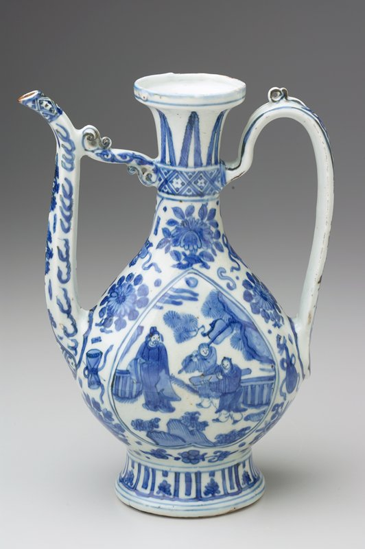 flattened body and hexagonal faceted spout with scroll-form strut; curved strap handle with top loop; flaring neck; blue and white decoration of figures in landscapes on sides; flowers and flames