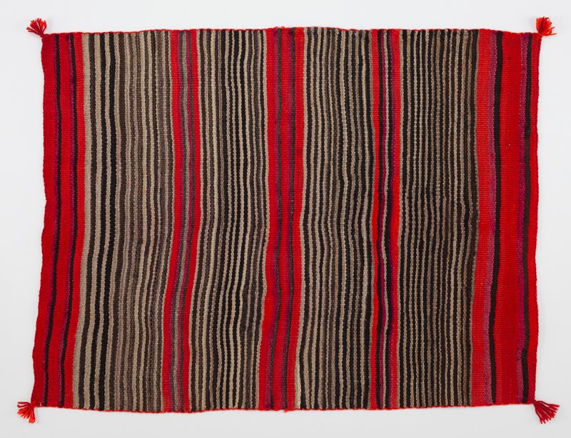 bands of thin black and gray stripes; five wider orange bands with thin black and magenta stripes; small red tassels at corners