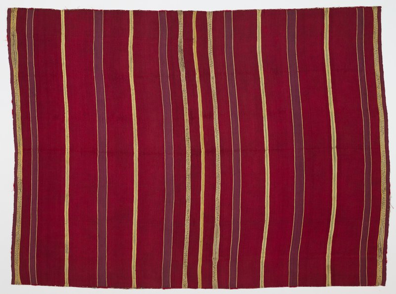 cranberry colored textile with purple, yellow, and light tan lines of varying thicknesses; tan lines have metallic thread details