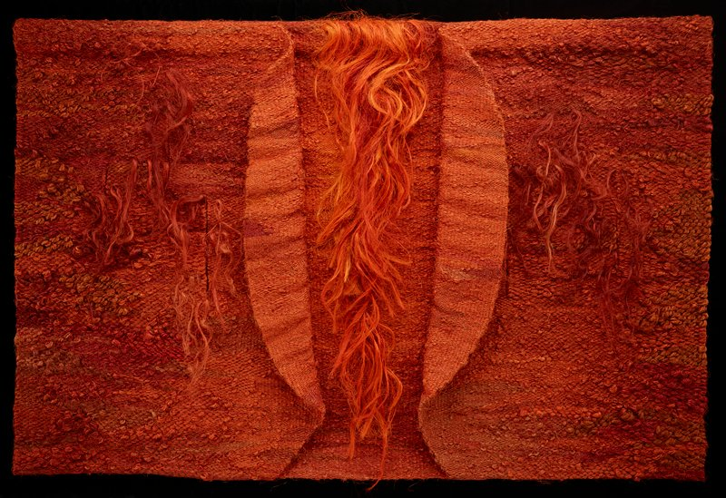 chunky, rectangular orange textile; two curved, vertical flaps at center separated by swath of long, vertical strands of sisal; three vertical slits on either side of vertical flaps, each with long strands; has wooden header