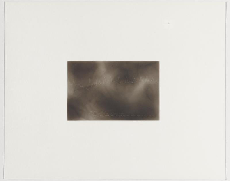 smokey grey background; irregular zigzagging line with dip downward near left