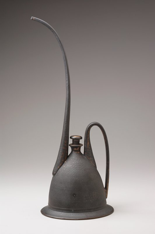 wide, flaring base with inverted, bottle-shaped vessel; long, thin handle; extremely long, tapering spout; small outward-flaring mouth with stopper; black glaze with gold metallic accents