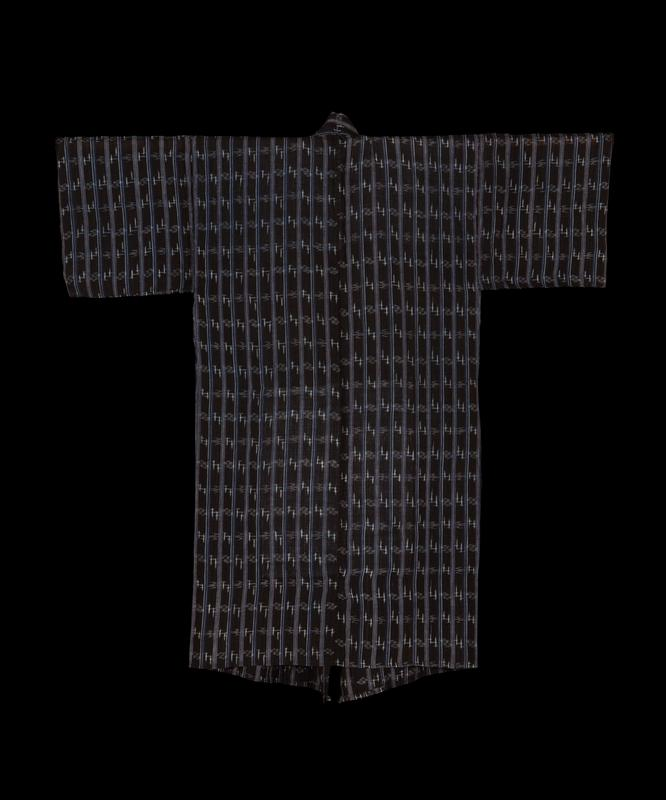 black cotton, with vertical light and dark blue stripes throughout, with smaller wavy patterns in between