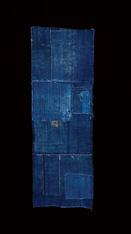 dark blue panel with blue patches on backside