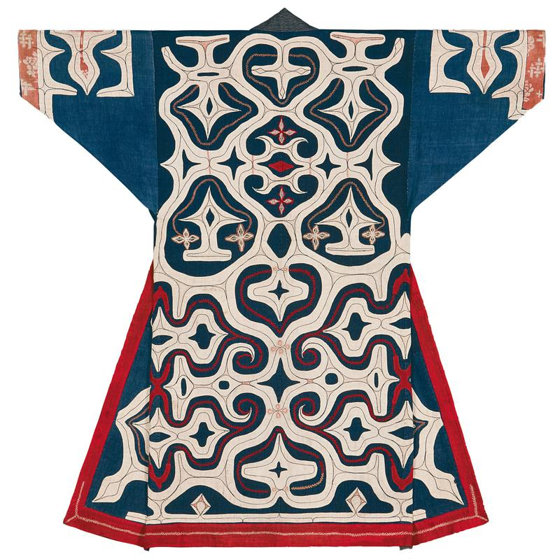 blue robe with abstract motif in white applique on entire back, shoulders, and sleeve cuffs; contrasting, decorative stitching on the applique; red decorative stitching on back; orange fabric inlay on sleeves