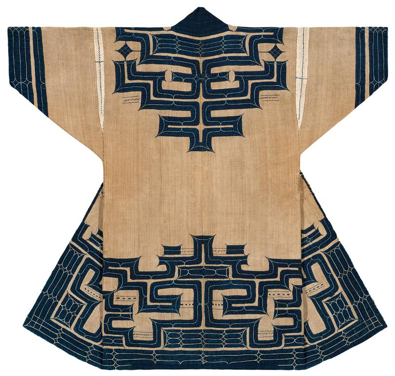 brown robe with navy blue applique trim and light blue embroidery around sleeves, collar, yoke, center opening, and bottom sections, and upper back; white accents around shoulder seams; blue tie on PR waist and blue patterned tie at PL center opening