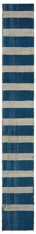 long skinny cloth of blue and beige alternating stripes