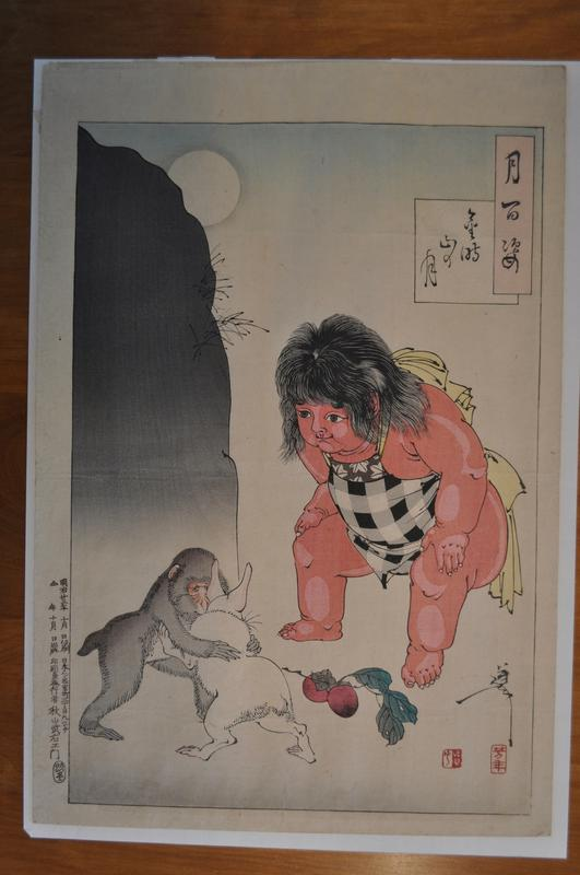 red-skinned chubby child watching a monkey and rabbit wrestling