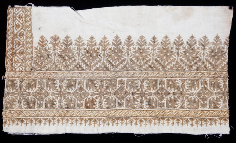 A border of white cotton embroidered with green silk in six varied ornato. Design perfect. Crosses and leafy borders.