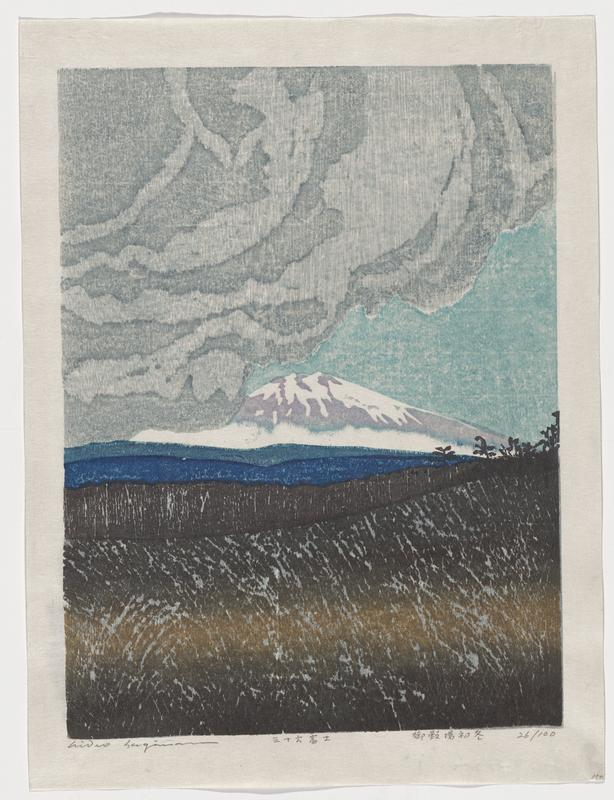 mountain scene with Mt. Fuji in distance; dark brown field in foreground, patch of blue in between; gray cloud over L and center sky