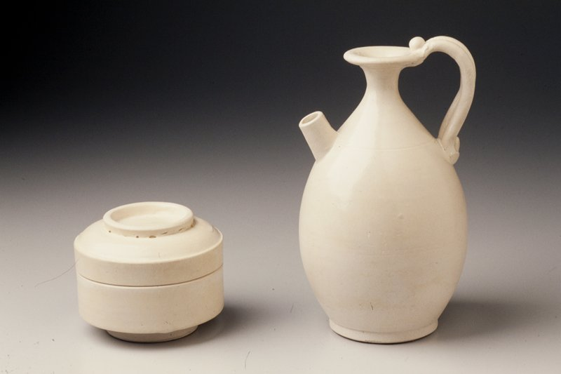 straight-sided bowl; bowl and lid have foot rims; white slip and clear glaze