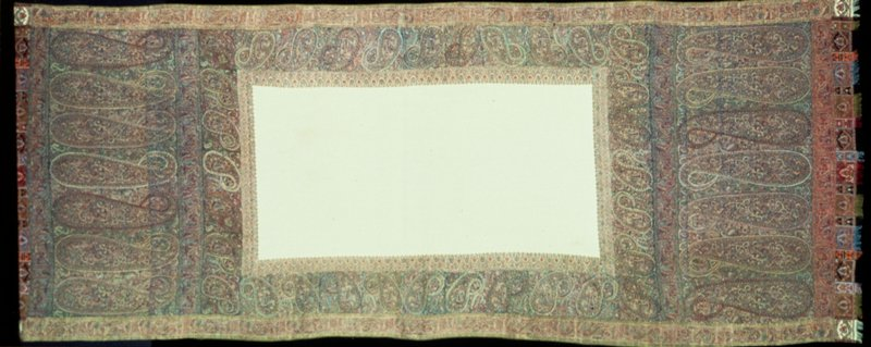 Doshalla, or long shawl, with plain white rectangular center and border of repeated palmettes with elongated neck, in soft blended colors giving and all-over tone of mauve. Embroidered fringed ends. Great weight of shawl indicates that it was probably not madein Kashmir.