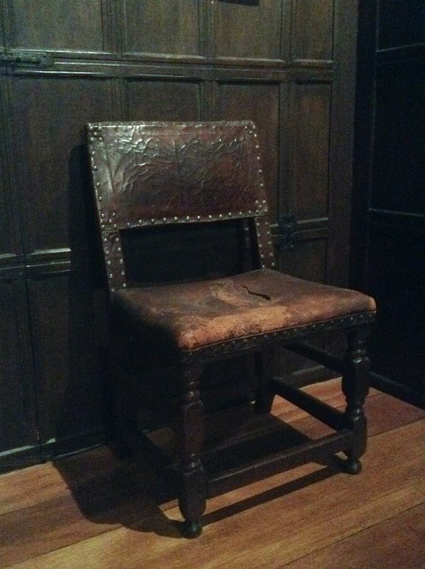 chair with leather seat and brass tacks