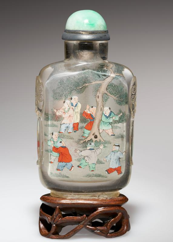 snuff bottle; crystal with green jade top; carved handles; painted inside; signed and sealed