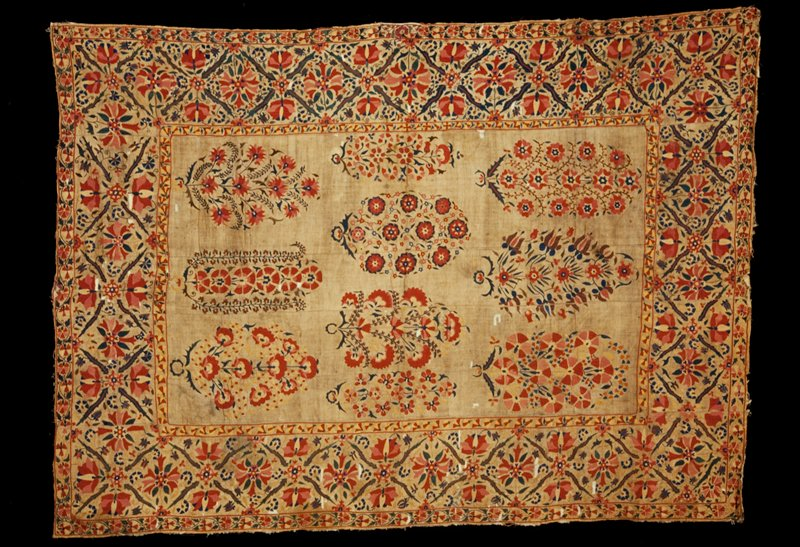 Quilted bed cover of linen embroidered with broad border inclosing center panel with naturalistic flower motives, chiefly red, blue and green. Linen embroidered.