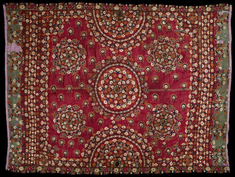 Bed cover (?); dark red satin ground, heavily embroidered in large circular designs and studded with small pieces of mirror.