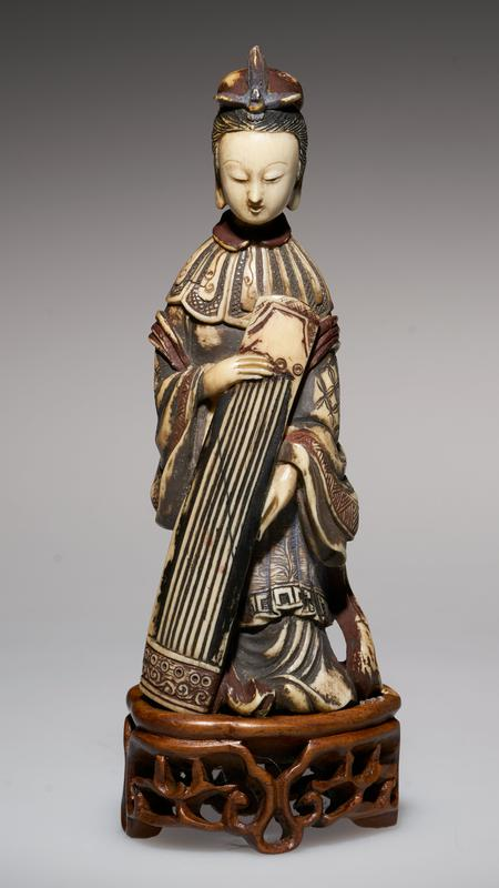 carved figure, holding the Zither