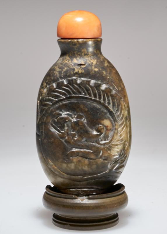 Snuff bottle. Old carved stone. Coral top. Dragon design.