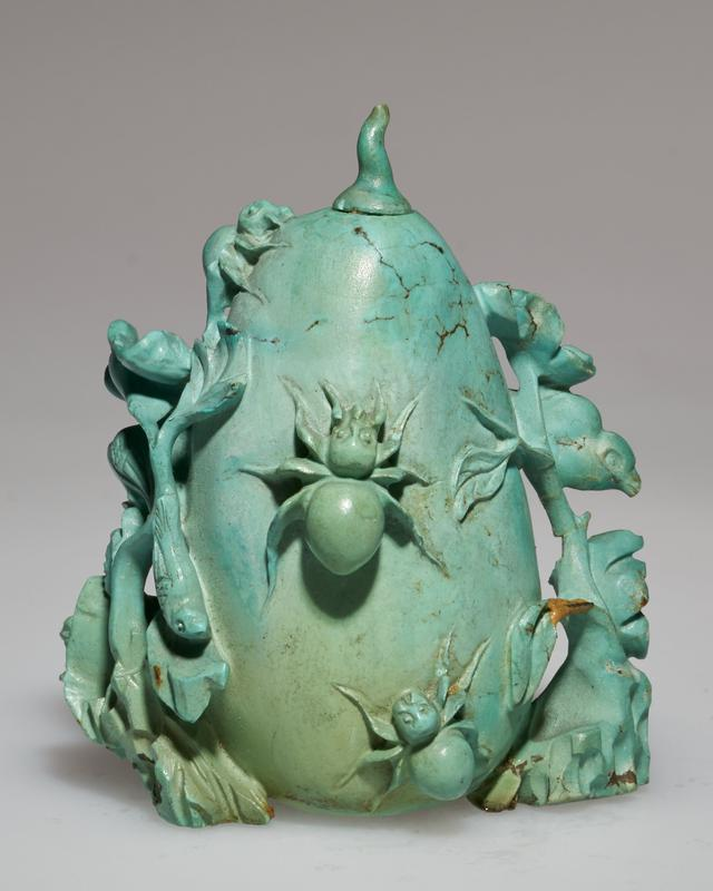 Snuff bottle, carved turquoise, pale green with bees in relief.