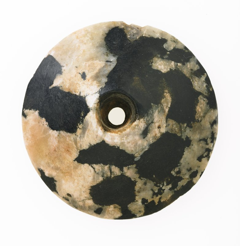 Mace Head Disk, stone, Egyptian, century? cat. card dims H. 7/8', D. 3' shallow conical, with opening in center; possibly a vase stand, black and white stone. Black and white alabaster.