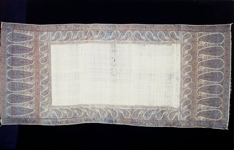 Doshalla, or long shawl with white ground of fine woolen material and wide border of palmettes woven at both ends in colors, mostly dark blue with some green and orange.