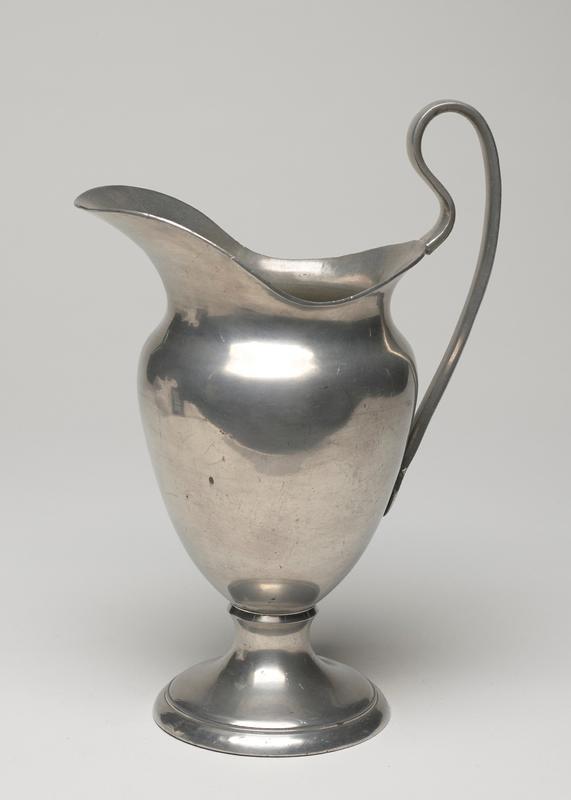 pear-shaped, on round base, narrow handle