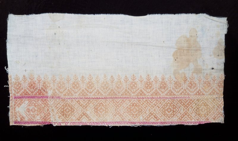 towel border embroidered on cotton in rose and apricot silk; conventionalized shrub and tree pattern and supplementary border of all-over lozenge pattern done in Moorish diagonal and straight stitch