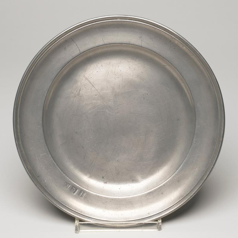 plate, round, with curving border and initials